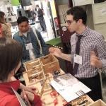 """Total visitor engagement and immersion into the Watermark space. Architects, designers, students and other visitors partake in the """"create your own faucet"""" contest. Many just wanted to tinker with the parts while they spoke to Avi Abel and other Watermark team members."""