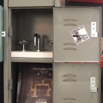 Real lockers were purchased to add to the booth, acted as storage, and additional display areas. Custom made stickers were applied to the lockers.