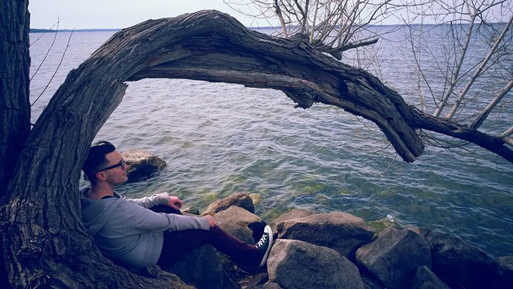 Andrew Hartwell relaxing by Lake Mendota, Madison, WI